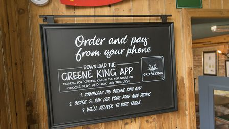 Signage Greene King customers can expect under the new rules Picture: ADAM SMY