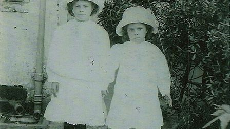 Left to right: Lily and Ethel Crane, Marian's great-aunts, standing in front of the family home in B