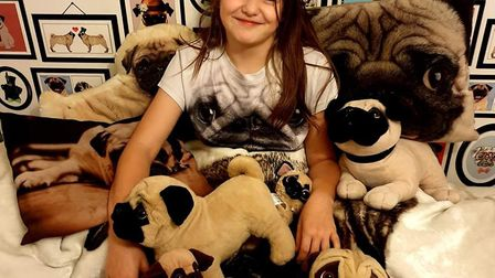 Pug crazy Emilie Garwood, who has finally been given her very own dream pet Picture: Russell Garwood