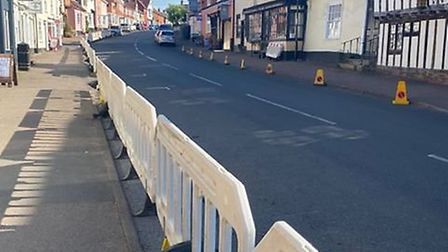The barriers appeared in Lavenham on Tuesday morning to create wider walkways so pedestrians could m