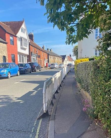 The barriers along some paths were in place to stop cars parking in Lavenham's high street Picture: