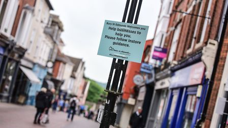 Signs have been put up around Bury St Edmunds reminding people to help businesses with the guideline