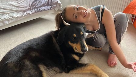 Grace with her service dog Scooby. Picture: WOLSTENHOLME FAMILY
