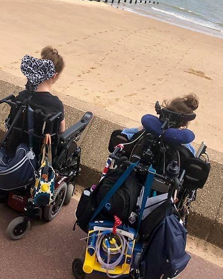 Grace at the beach in Frinton with her friend Syd. Picture: WOLSTENHOLME FAMILY
