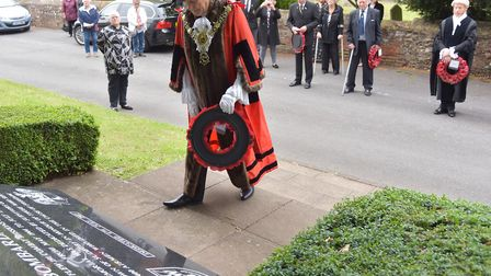 Mayor of Sudbury Jack Owen lays a wreath at the memorial to the 486th Bombardment Group. Picture: SO