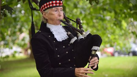 Sudbury town piper Tricia Drawbridge plays during the service at the St Gregory's church memorial. P