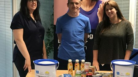 Joanne Forsyth, Michael Connolley and Terri Hazel with some of the items collected by staff at Woven