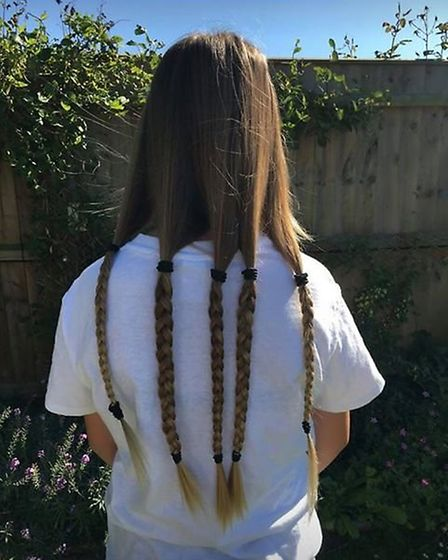 Poppy Harvey with the long hair she grew in lockdown in aid of the Little Princess Trust Picture: LO