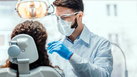 Dentists are having to wear more heavy-duty PPE due to the coronavirus. Suffolk practices have asked