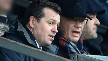 Lee O'Neill (general manager of football operations) talks to Ipswich Town club owner Marcus Evans.