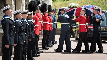 Service personnel carrying the coffin of forces sweetheart Dame Vera Lynn Picture: Stefan Rousseau/P