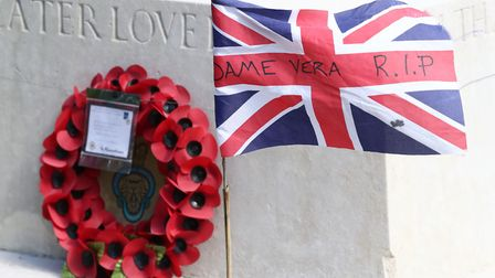 A wreath of poppies and a flag on the war memorial in Ditchling in honour of Dame Vera Picture: Gare