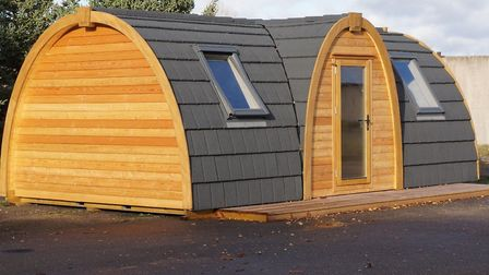 Pictures of the proposed log cabins, designed by LV Camping Pods, which would be installed at the si