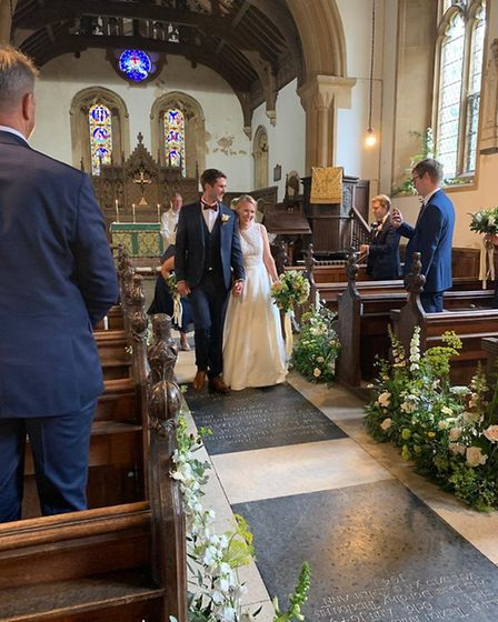 Beth and Ben Hadingham walk down the aisle after getting married on Saturday, July 4. Picture: PAULI