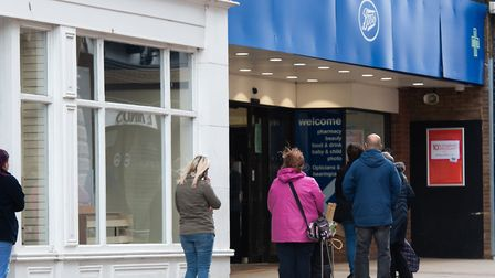 People waiting to get iunto Boots in Ipswich town centre Picture: SARAH LUCY BROWN
