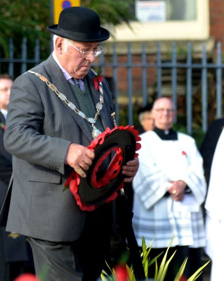 Mr Oliver lays a wreath on Remembrance Day as chairman of Bury St Edmunds Town Council in 2014. Pict