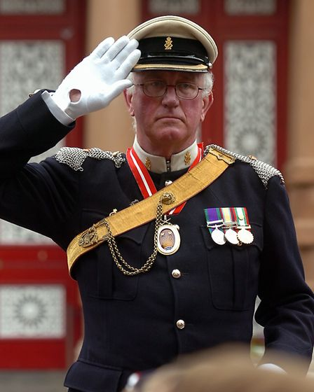 Major Philip Hope-Cobbold takes the salute during the parade by members of the Royal British Legion