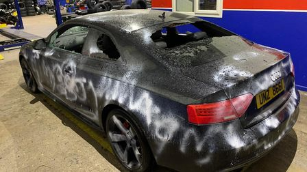 The Audi A5 was sprayed with paint, keyed and all the windows were smashed Picture: CONTRIBUTED