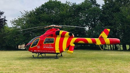 An air ambulance landed at Kyson Primary School after a nearby resident suffered a cardiac arrest P