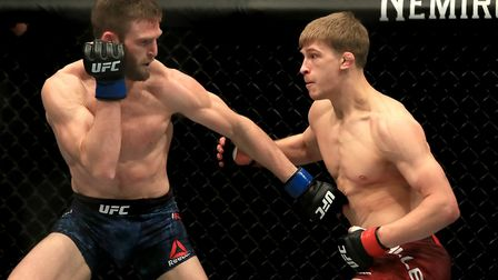 Arnold Allen, right, is unbeaten in the UFC and ranked 12th in the world featherweight rankings. He