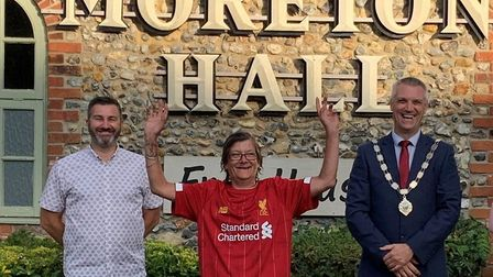 Liverpool fan Sylvie Smith with Nigel Canham, left, and Mayor of Bury St Edmunds Peter Thompson at t