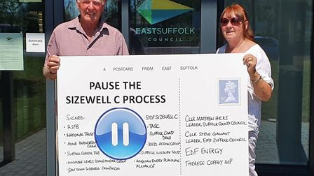 Campaigners Alan and Jean Hatt deliver a special postcard to East Suffolk Council Picture: STOP SIZE