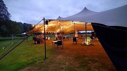 Diners at Tuddenham Mill can eat under a stretch tent in a meadow Picture: Tuddenham Mill