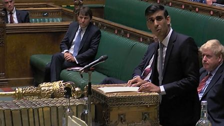 Chancellor of the Exchequer Rishi Sunak delivers a summer economic update watched by Prime Minister