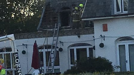 Fire crews tackle the incident at the Highwaymans guest house in Risby, near Bury St Edmunds Pictur