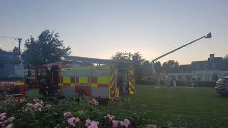 Fire crews use a turntable ladder at The Highwaymans in Risby Picture: WILL JEFFORD
