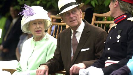 The Queen and Duke of Edinburgh in 2002, watching the proms concert in the Abbey Gardens in Bury St