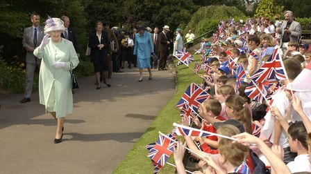 The Queen waves to schoolchildren on her visit to Bury St Edmunds in 2002. Picture: PA