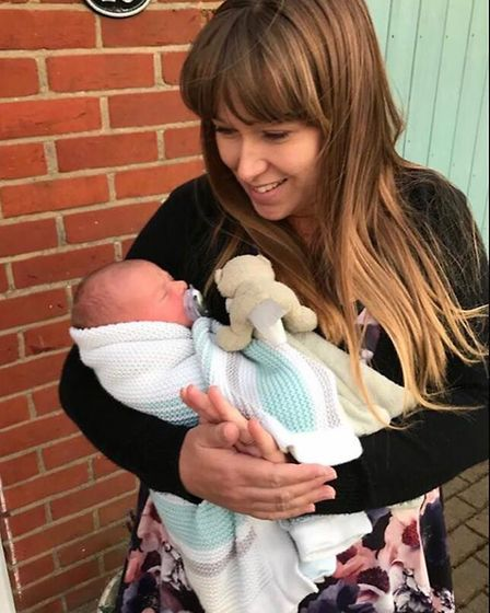 """Mum Meg Emeny from Felixstow with her newborn baby Finley, who she said is her """"rainbow child"""". Pict"""