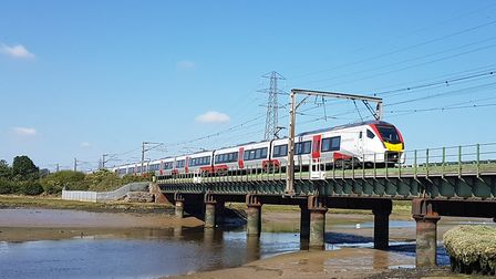 One of Greater Anglia's new Stadler Intercity trains crosses the Essex/Suffolk border at Cattawade n