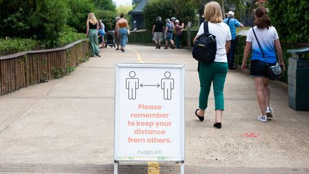 Signs have been put in place across Colchester Zoo to remind people to socially distance Picture: S