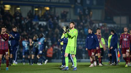 Will Norris applauds the travelling support at Wycombe Wanderers. Picture Pagepix