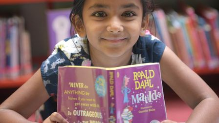 Sanvi Sinha enjoying some reading in Ipswich County Library last year. Picture: SARAH LUCY BROWN