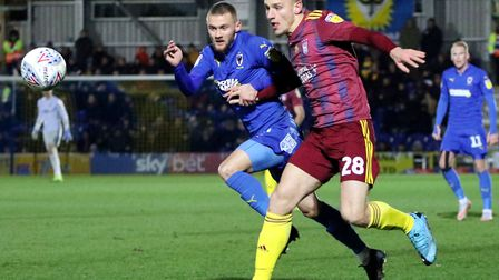 Shane McLoughlin and Luke Woolfenden battle for the ball during Town's 0-0 draw at AFC Wimbledon Pho