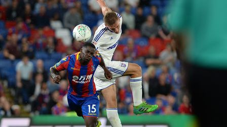 Luke Woolfenden beats Jeffrey Schlupp to the ball in the Carabao Cup clash at Crystal Palace