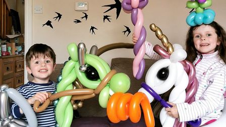 Emma Nettleton's children trying out some of her amazing balloon creations. Picture: EMMA NETTLETON
