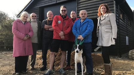 Andy King, chairman of Suffolk Lowland Search and Rescue (SULSAR), with volunteers outside their hea