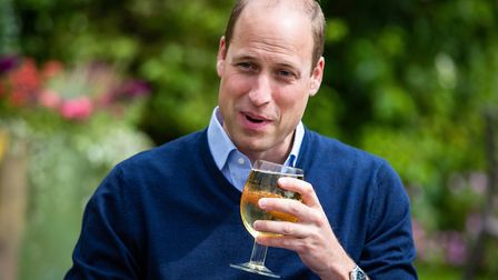The Duke of Cambridge takes a sip of an Aspalls cider at The Rose and Crown pub in Snettisham, Norfo