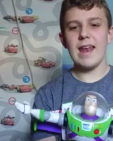 """Some students performed with Buzz Lightyear toys in memory of Dr Letman's catchphrase: """"I'm going to"""