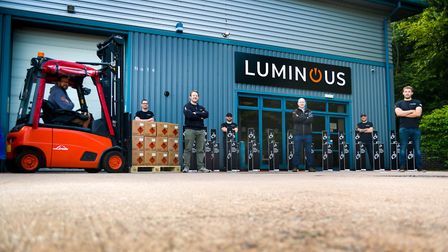 Some staff outside Luminous's warehouse in Exeter, including Edwin Samkin's business partner Mike Ba