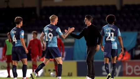 Fleetwood Town manager Joey Barton shakes hands with Wycombe Wanderers Jack Grimmer after their pla