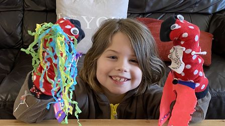 A member of the Melton Brownies with her sock puppets for the ODD SOX unit meeting activity online.