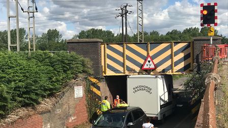 The road below the railway bridge in Manningtree is blocked, with traffic being diverted over the ra
