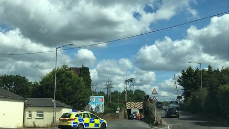 Police are at the scene in Manningtree where a horse box has become stuck under a railway bridge Pic