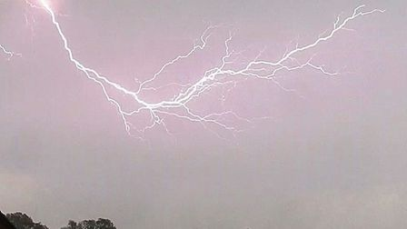 This stunning picture of the lightning was taken over Great Cornard, near Sudbury. Picture: JOHN FIT