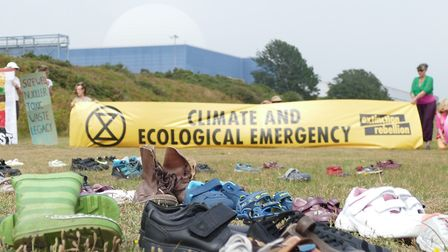 The demonstration by Extinction Rebellion aganst Sizewell C uses shoes to symbolise the loss of envi